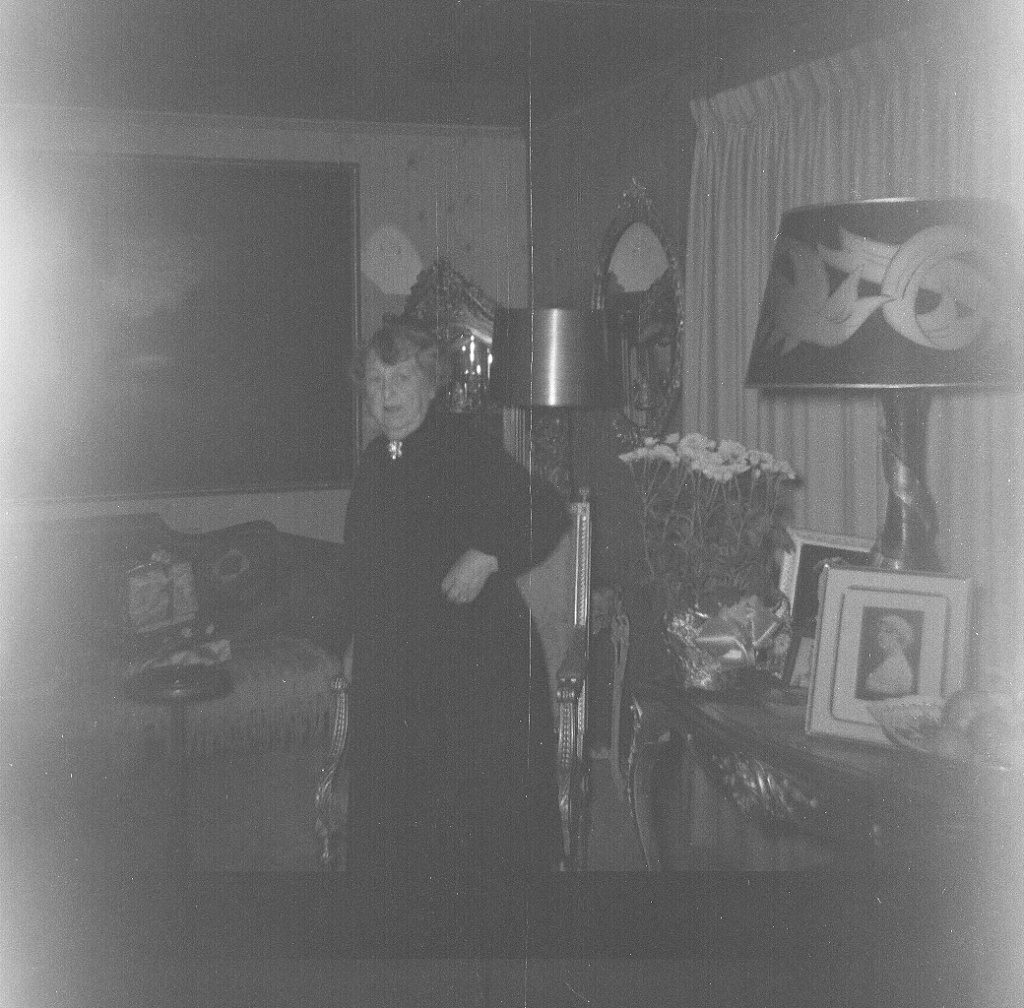 Same roll of 120 film, same house.   We have not yet identified the woman.   I was impressed by the relatively lavish furnishings.